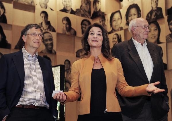 Melinda Gates speaks to the media with her husband, Bill Gates, and his father, William H. Gates Sr., during a tour of the new visitor center at the Bill and Melinda Gates Foundation campus in Seattle on Feb. 1.
