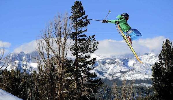 A skier takes to the air at Mammoth Mountain. A series of storms has brought out skiers and boarders to the Eastern Sierra resort.