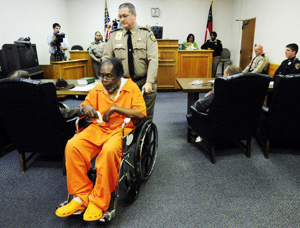 Frank Louis Reeves is wheeled out of a Macon, Ga., courtroom Wednesday.