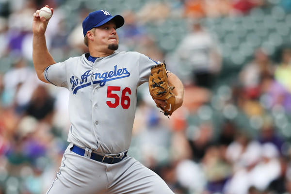 The former Dodgers right-hander is staying in L.A., but signing with the Angels for two years and $15 million, according to multiple reports.