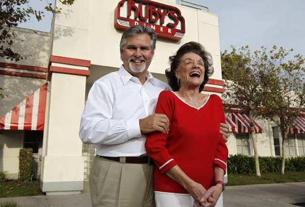 Founder Doug Cavanaugh, left, jokes with his mother, Ruby, in front of his Tustin branch on Tuesday. Thirty years ago, Cavanaugh opened his first Ruby's Diner, named after his mother, at Balboa Pier in Newport Beach.