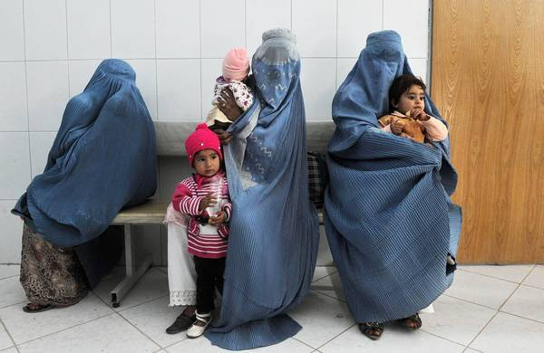 Afghan women wait in Herat to have their children vaccinated against polio. One volunteer vaccination worker was slain last weekend in Kapisa, north of Kabul, the Afghan capital.