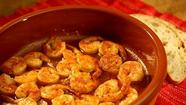 Dinner doesn't get much simpler than a nice helping of sizzling shrimp with a touch of garlic and a sprinkling of hot pepper, and it comes together in less than half an hour. That's just enough time to slice a baguette (to soak up all those amazing juices) and pour a couple of glasses of wine before you settle in for the evening.