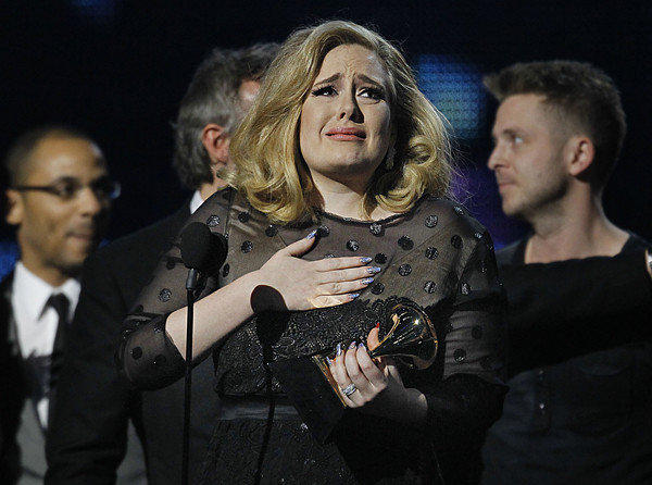 An emotional Adele reacts while accepting her sixth Grammy of the night during last year's Grammy Awards.