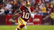 <strong>—</strong> To see how much influence Robert Griffin III is beginning to accumulate in the Washington, D.C. area, consider that the Washington Redskins quarterback is being given credit for helping the last-place Washington Wizards upset the reigning NBA champion Miami Heat Tuesday night. All he did was attend the game.