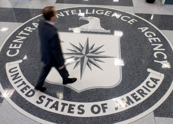 A man crosses the Central Intelligence Agency logo in the lobby of CIA Headquarters in Langley, Va.