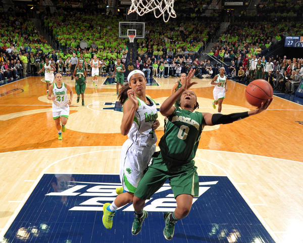 Baylor's Odyssey Sims is fouled by Skylar Diggins in the first half.