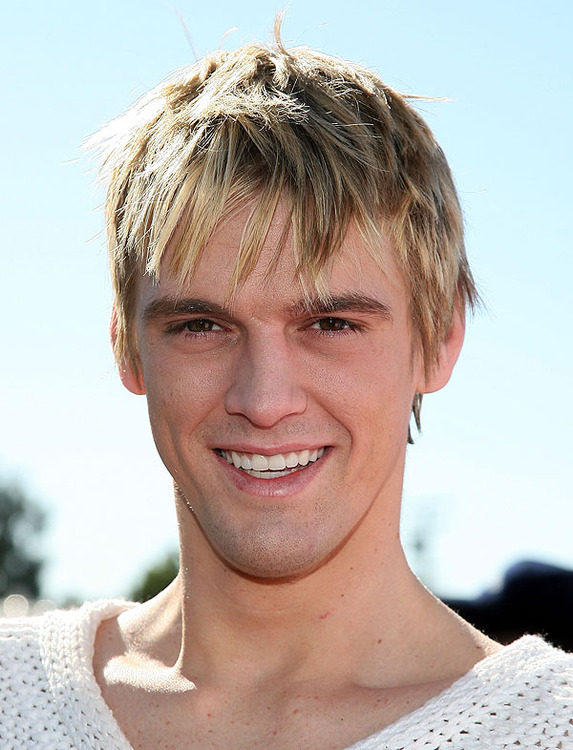 What does Aaron Carter do exactly?  Apparently he sings and likes to appear on reality-TV shows.  And date famous women.  Whew!  That's a lot for a newly minted 23-year-old.
