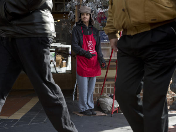 Salvation Army bell ringer Noemi Rivera, of Bethlehem, waits for donations in front of Moravian bookshop in Bethlehem on Wednesday.