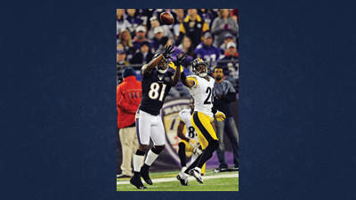 Baltimore Ravens wide receiver Anquan Boldin (81) reaches for a pass under pressure form Pittsburgh Steelers defensive back Cortez Allen, right, during the first half of an NFL football game in Baltimore, Sunday.