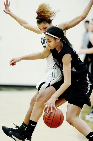 South Hagerstown's Chelsey Scott, back, pressures Winters Mill's Tasha Magruder during the first quarter of Wednesday night's girls basketball game at South.