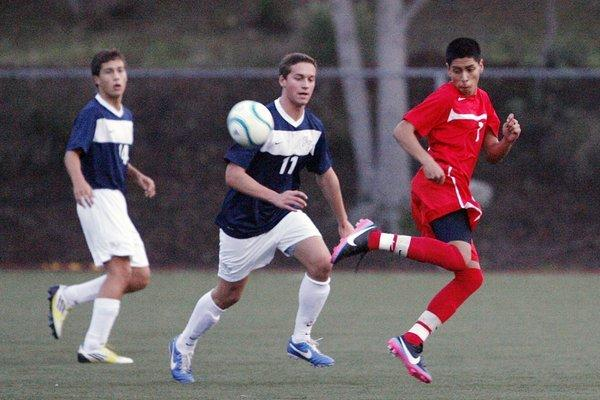 Marshall's Alex Palma, right, controls the ball during a game against Flintridge Prep at Glendale Sports Complex.