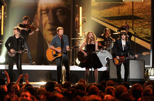 "The Band Perry was joined by Dierks Bentley to pay tribute to country legend Johnny Cash. They performed Cash's ""Jackson."""
