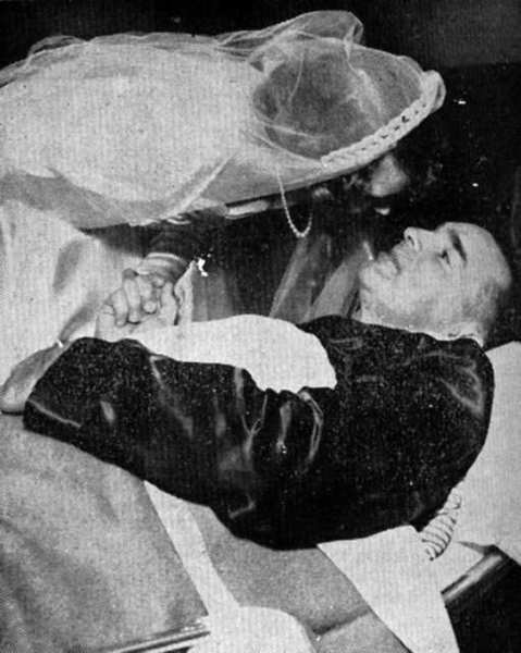 Rodney Lilyquist of Flintridge gets a kiss from his daughter, Carla, at her wedding. The senior Lilyquist was recovering from spinal surgery and arranged to be delivered on a stretcher from his hospital room to North Glendale United Methodist Church to participate in Carla's November 1952 wedding to Wallis I. Benson.