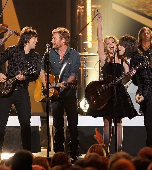 Dierks Bentley (center) and Neil Perry, Kimberly Perry, and Reid Perry of The Band Perry onstage at The GRAMMY Nominations Concert Live!! held at Bridgestone Arena on December 5, 2012 in Nashville, Tennessee.