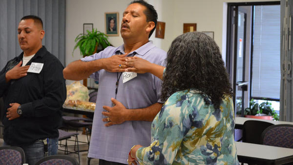 County Public Health Department health education specialist Raul Martinez (center), practices a breathing exercise with the help of Viviana Criado, a Stanford University community outreach trainer, as part of the Tomando Control de Su Salud workshop Tuesday in El Centro.