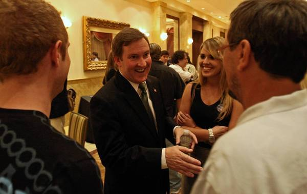L.A. mayoral candidate Kevin James chats with guests after a candidates' forum in September.