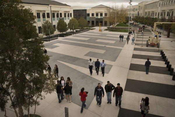 Facebook employees walk the grounds of Facebook's Menlo Park, Calif., headquarters.