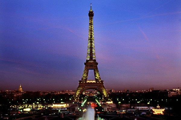 A view of Paris at twilight. Under new regulations, the city may be left in the dark late at night to save money.