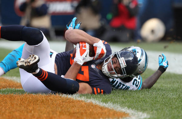 Bears tight end Kellen Davis scores a touchdown in front of Carolina Panthers free safety Sherrod Martin during the second half of their game at Soldier Field on Oct. 28.