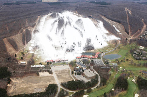 Harbor Springs ski resort Boyne Highlands, as seen here in this aerial photo taken Wednesday, show snow sticking to the slopes despite the warmup earlier this week. Overnight lows are expected to be in the 20s the rest of the week.