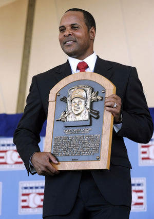 Former Cincinnati Reds star Barry Larkin holds his plaque after his induction into the Hall of Fame.