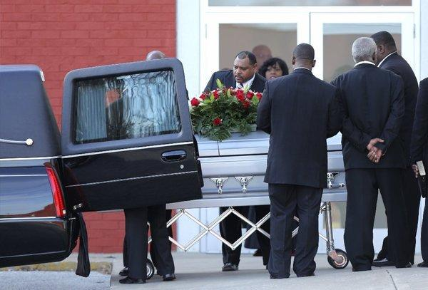 Pallbearers place a coffin with the body of Kansas City Chiefs linebacker Jovan Belcher into a hearse Wednesday.