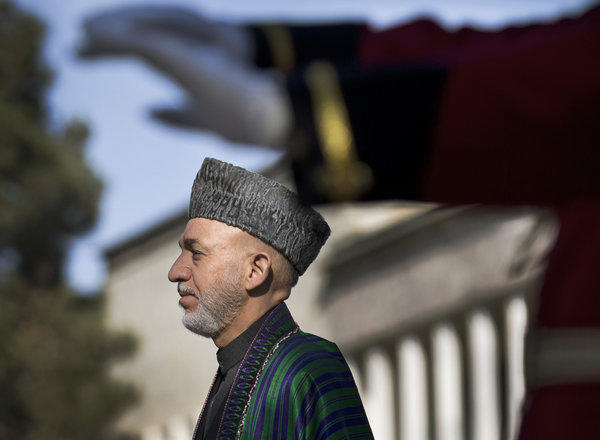 Afghan President Hamid Karzai, shown in an October photo, has asked a special commission investigating the death of a woman volunteering with a vaccination program to report to him within four days.