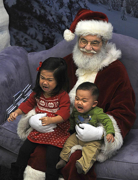 Kayla Lee, 2 1/2 and her brother Gavin Lee, 7 months, are not so sure about sitting with Santa Claus for a picture at the West Farms Mall in West Hartford, Conn.