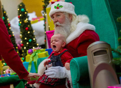 Marcia Adams with 9-month-old Leah visits with Santa in the atrium of Yorktown Mall in Lombard, Ill.