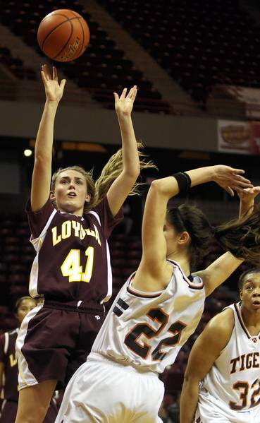 Loyola Academy's Anna Schueler shoots over Edwardsville's Sarah Parker in the second half of a 4A girls state basketball semifinal at Illinois State University's Redbird Arena on March 2.
