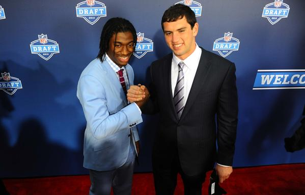 Stanford quarterback Andrew Luck (right) and Baylor quarterback Robert Griffin III (left) pose for a photo on the red carpet before the start of the 2012 NFL Draft at Radio City Music Hall.