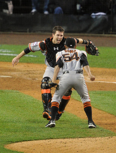 San Francisco Giants pitcher Sergio Romo (54) celebrates with catcher Buster Posey after game four of the 2012 World Series against the Detroit Tigers at Comerica Park. The Giants won 4-3 to sweep the series.