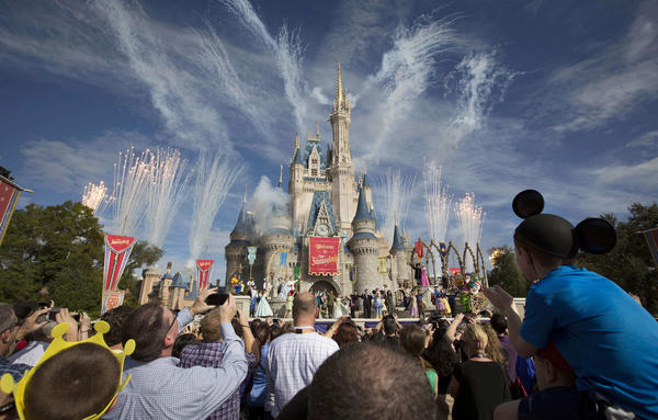 Fireworks go off around Cinderella's castle during the grand opening ceremony for Walt Disney World's new Fantasyland in Lake Buena Vista, Florida