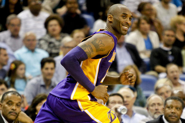 Los Angeles Lakers shooting guard Kobe Bryant (24) smiles after hitting a shot in the fourth quarter of a game against the New Orleans Hornets at the New Orleans Arena. The Lakers defeated the Hornets 103-87.