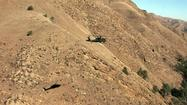 Black Hawk helicopter flies itself over mountain range in test