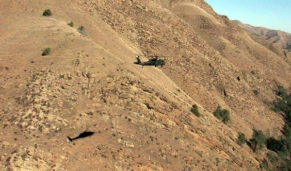 A Black Hawk helicopter flies low and slow. The aircraft was able to sense surrounding terrain, assess risk and avoid possible threats.