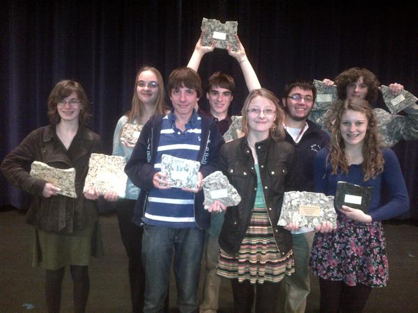 Holding their Petoskey Rocks! trophies following the Elice Howard Memorial Swing Tournament are members of the Petoskey High School debate team, (front row, from left) Declan Akins, Grace Marshall and Mary Louise Mooradian; (back row) Megan Keller, Paige Petrowski, Jackson Burek, Eli Ellison and Brett Kimbrue. Not pictured, Olivia Tanner.