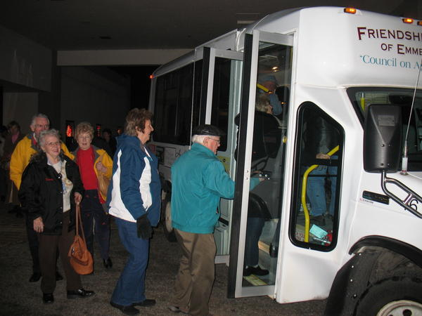 Guests prepare to embark on a tour of area Christmas light displays on one of the Friendship Centers transit buses. This year's Tour of Lights, hosted by the Kiwanis Club of Petoskey, will take place on Tuesday, Dec. 11, beginning with a soup and sandwich supper at 5 p.m. at the Petoskey Friendship Center.