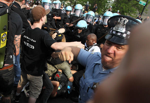 A Chicago police officer is caught punching a NATO protestor in May.