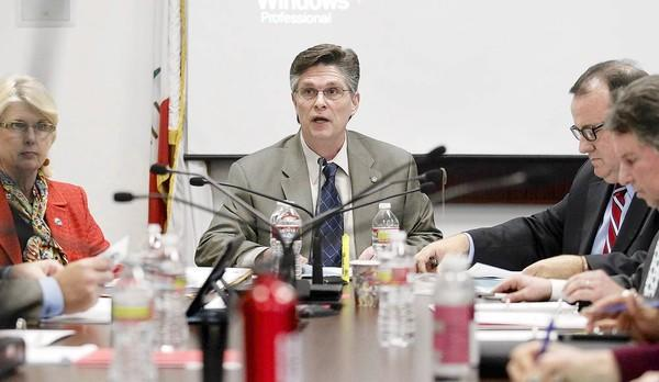 Mayor Eric Bever, pictured here in March, left the dais Tuesday after about eight years of service in Costa Mesa. He was termed out.