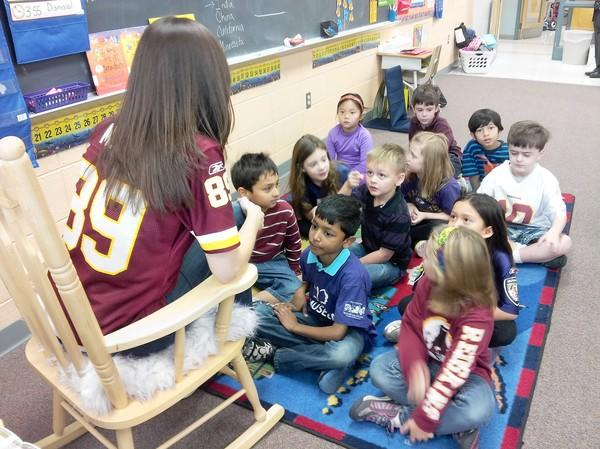 Students in Valerie McConoughy's first-grade class at Veterans Elementary School in Ellicott City have split loyalties - half are Baltimore Ravens fans and half are Washington Redskins fans.