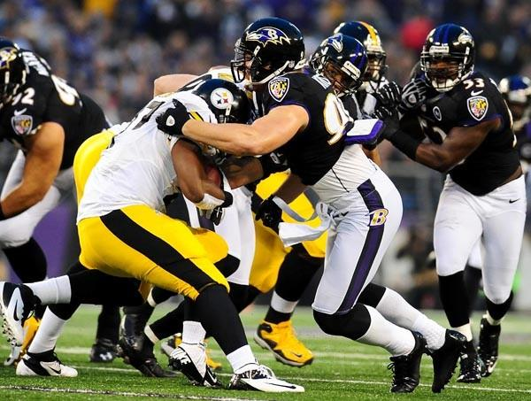 Baltimore Ravens linebacker Paul Kruger (99) sacks Pittsburgh Steelers quarterback Charlie Batch (16) at M&T Bank Stadium.