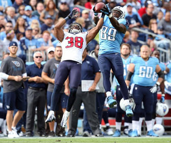 The Tennessee Titans' Jared Cook (89) catches a pass over the Houston Texans' Danieal Manning (38) during Sunday's 24-10 Texans' win at LP Field in Nashville, Tenn. The Texans, 11-1, will battle the New England Patriots, 9-3, on Monday night.