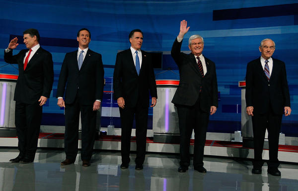 Former Republican presidential candidates, left to right, Texas Gov. Rick Perry, former Sen. Rick Santorum of Pennsylvania, former Massachusetts Gov. Mitt Romney, former House Speaker Newt Gingrich and Rep. Ron Paul (R-Texas) pose for photos before participating in a Fox News, Wall Street Journal-sponsored debate in Myrtle Beach, S.C.