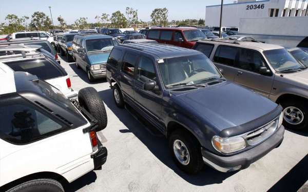 "Older, gas guzzlers are lined up for scrapping as part of the popular ""cash for clunkers"" program at a lot in Torrance, Calif."
