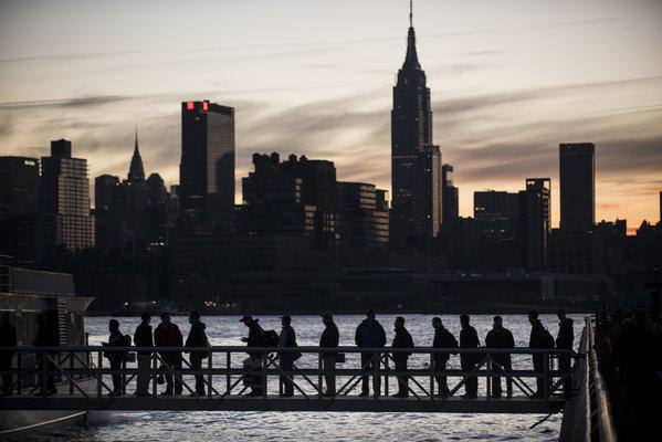 The day after Sandy struck the New York area, people wait to board a ferry in Hoboken, N.J.