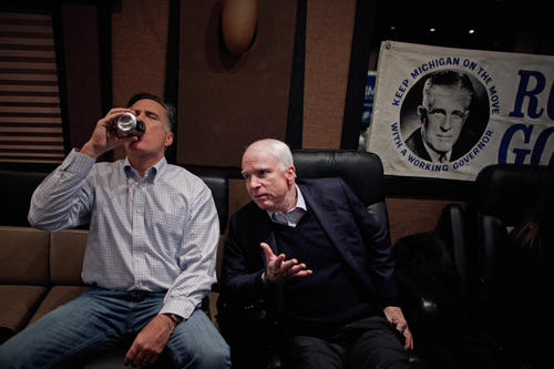 Mitt Romney talks with former presidential nominee Sen. John McCain (R-Ariz.) on Romney's campaign bus in between events near Manchester, N.H.