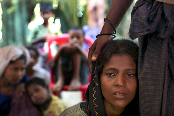 Rohingya patients wait for medical care at a government-run medical clinic on the outskirts of Sittwe, Myanmar.