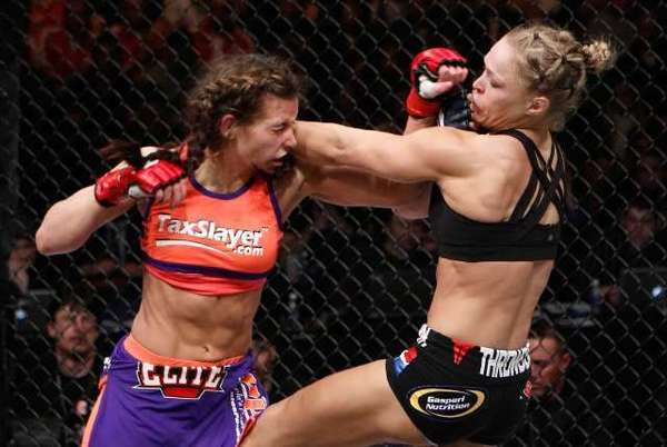 Ronda Rousey, right, trades blows with Miesha Tate during the Strikeforce event in Columbus, Ohio, on March 3.
